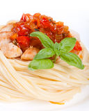 Chicken in sweet and sour sauce with pineapple and pasta Royalty Free Stock Photos