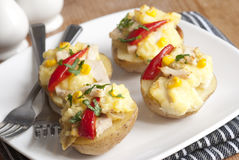 Chicken and sweetcorn jackets Stock Image