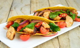 Chicken tacos. Mexican chicken tacos with sundried tomatoes and onions stock image