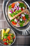 Chicken Tacos with vegetables served on the table.  Stock Images