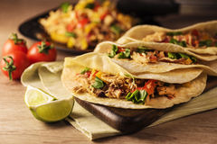 Chicken Tacos. On a wood background royalty free stock photo