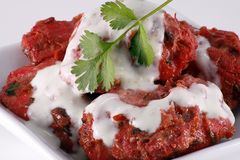 Chicken tandoori. Indian starter on white dish, with coriander and mint sauce dressing Royalty Free Stock Photo