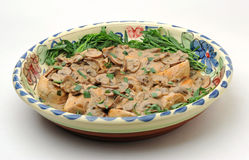 Chicken tarragon dish, in large platter. A large platter of Chicken Tarragon, freshly made, white background Stock Photo