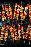 Chicken teriyaki with vegetables on black baking. Chicken teriyaki kebabs with vegetables on black baking Stock Photo