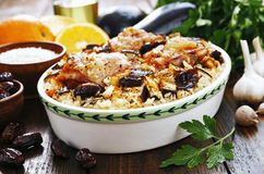 Chicken thigh baked with rice, eggplant and figs Royalty Free Stock Photo