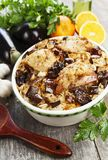 Chicken thigh baked with rice, eggplant and figs Stock Photo