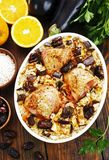 Chicken thigh baked with rice, eggplant and figs Stock Image