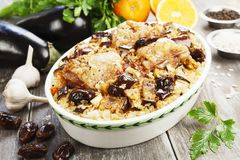 Chicken thigh baked with rice, eggplant and figs Stock Images