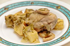 A chicken thigh cooked with mushrooms royalty free stock photos