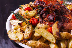 Chicken thigh with rosemary and potatoes-2. Stock Photos