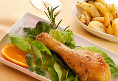 Chicken thigh with salad and potatoes - closeup Royalty Free Stock Photography