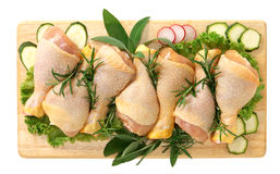 Chicken thighs. On wooden board Royalty Free Stock Image