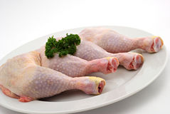 Chicken thighs. Four chicken thighs on the white background royalty free stock photos