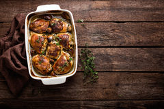 Chicken thighs. Baked with apples Stock Images