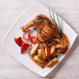 Chicken thighs and chips on a plate. top view Royalty Free Stock Photography