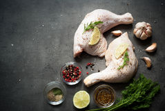 Chicken thighs on a dark background. Royalty Free Stock Photography
