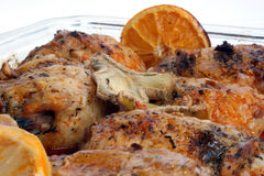 chicken thighs with orange and lemon Stock Photos