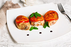 Chicken thighs with orange plate mint balsamic sauce baked still-life leg, thigh, turkey Stock Image