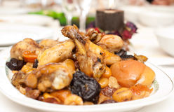 Chicken thighs on a plate Stock Images
