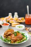 Chicken thighs with spices, soy sauce, green onion and side dish royalty free stock photos