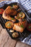 Chicken thighs and vegetables on the grill pan vertical top view Stock Images