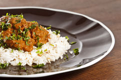 Chicken tikka. Masala served  with rice and garnished with cilantro leaves Royalty Free Stock Image