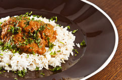 Chicken tikka. Masala served  with rice and garnished with cilantro leaves Stock Photography