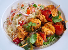 Chicken Tikka with Couscous Salad. Indian Chicken Tikka  tandoori snack with Couscous Salad Royalty Free Stock Photos