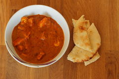 Chicken Tikka Curry with Naan Bread Stock Images