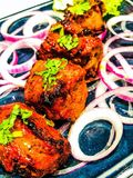Chicken tikka Indian food. Chicken tikka Indian cuisine food spicy red yoghurt Tikka tandoori spicy spices skewers serving salad red meat meal masala marinated stock photos