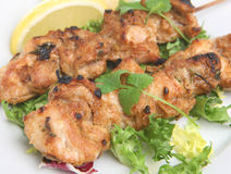 Chicken Tikka Kebabs. Chicken pieces marinated in curry sauce and baked in a tandoor oven Stock Photos