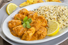 Chicken Tikka Masala. An Indian meal of chicken tikka masala and pilau rice, with naan bread on the side. Britain's favourite curry, more popular than fish and Royalty Free Stock Photo