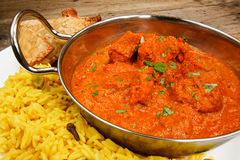 Chicken tikka masala in balti dish with rice royalty free stock photos