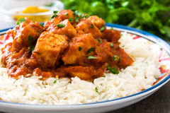 Chicken tikka masala with basmati rice on wood Royalty Free Stock Photography