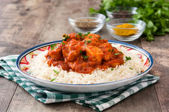 Chicken tikka masala with basmati rice on wood. En table royalty free stock photos