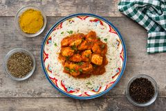 Chicken tikka masala with basmati rice on wood Stock Image