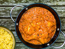 Chicken Tikka Masala Indian Takeaway Curry With Pillau Rice Stock Photo