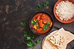 Chicken tikka masala with rice. Indian food. Top view, copy space.