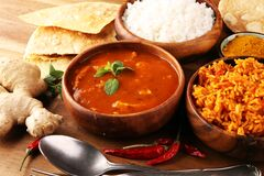 Free Chicken Tikka Masala Spicy Curry Meat Food In Pot With Rice And Naan Bread. Indian Food On Table Royalty Free Stock Image - 175100106