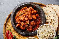 Chicken tikka masala spicy curry meat. Food in metal plate, rice and naan bread close-up Royalty Free Stock Photo