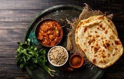 Chicken tikka masala spicy curry meat food with rice. And naan bread on dark background royalty free stock image