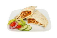 Chicken tikka naan bread. With salad on a plate isolated against white Stock Image