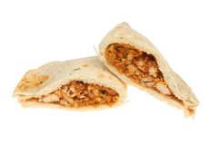 Chicken tikka naan bread. Naan bread stuffed with chicken tikka isolated against white Stock Images