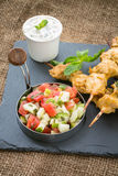 Chicken Tikka, Raita and ketchumbar salad Stock Image