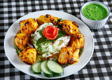 Chicken tikka with salad and sauce Royalty Free Stock Photography