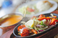 Chicken Tikka Sizlar. Hot smoking and sizzling Chicken Tikka woith rice, sauce and salad Royalty Free Stock Photos