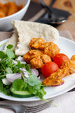 Chicken tikka skewers. With pita bread and salad Royalty Free Stock Photos
