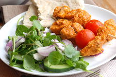 Chicken tikka skewers. With pita bread and salad Royalty Free Stock Photo