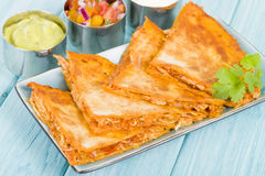 Chicken Tinga Quesadillas. Mexican quesadillas filled with spicy shredded chicken and cheese Stock Photo