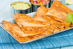 Chicken Tinga Quesadillas. Mexican quesadillas filled with spicy shredded chicken and cheese Royalty Free Stock Image